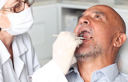 man getting denture and teeth cleaned