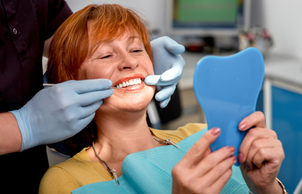Woman getting denture checked